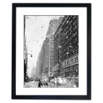 Bits of paper rain down on the street in Manhattan as rumours of Japan's surrender surface, 1945 Framed Print