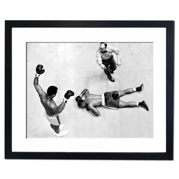 Champion Cassius Clay stands over challenger Zora Folley, Madison Square Garden, New York 1967 Framed Print