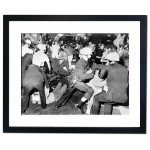 Chicago Police and Anti Vietnam War demonstrators mix it up on Michigan Avenue, 1968 Framed Print