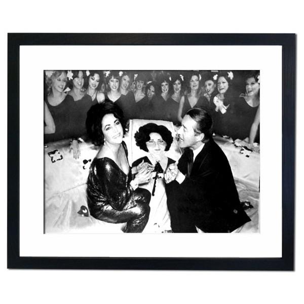 Elizabeth Taylor celebrating 46th Birthday at Studio 54, New York Framed Print