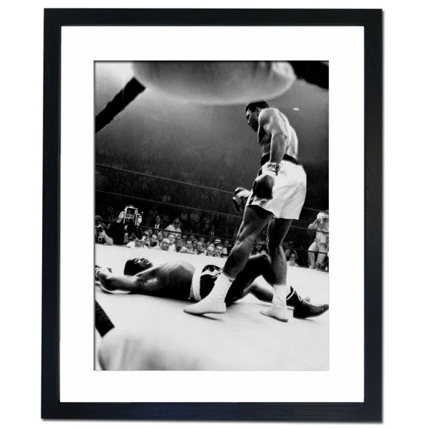 Muhammed Ali towering over Sonny Liston in first round, Lewiston 1965 Framed Print