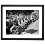 Scooters lined up in the streets of Italy Framed Print